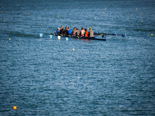 Rowing teams practice on Melton Lake on Wednesday, March 22, 2017. A half million dollar project that added an eighth lane to the rowing course recently finished.