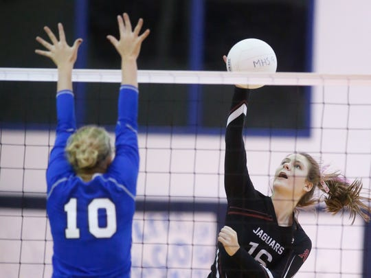Appoquinimink's Caelen Brooks (16) hits against Middletown's Madison Keller in the second game of the Jaguars' 3-0 win at Middletown High Wednesday.