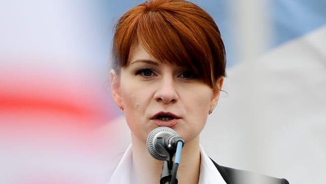 In this photo taken on Sunday, April 21, 2013, Maria Butina, leader of a pro-gun organization in Russia, speaks to a crowd during a rally in support of legalizing the possession of handguns in Moscow, Russia. Butina, a 29-year-old gun-rights activist, served as a covert Russian agent while living in Washington, gathering intelligence on American officials and political organizations and working to establish back-channel lines of communications for the Kremlin, federal prosecutors charged Monday, July 16, 2018.