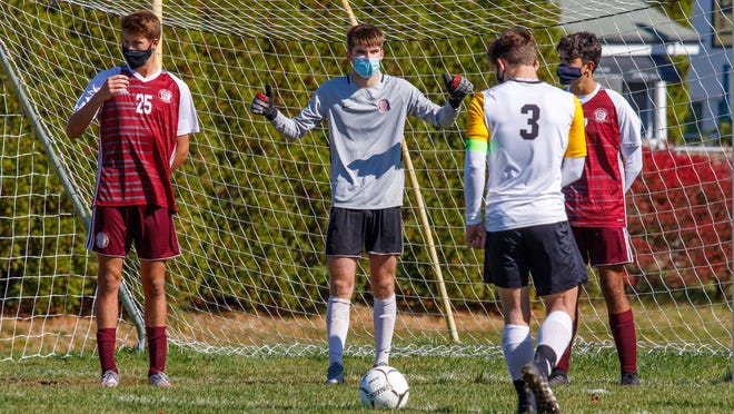 Bishop Stang senior goalie Declan Markey tries to figure out a way to defend an indirect free kick from just six yards away during a 1-0 loss to Bishop Fenwick on Saturday.