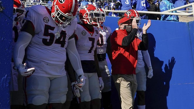 Georgia head coach Kirby Smart and his players prepare to run onto the field before an NCAA college football game against Kentucky, Oct. 31, 2020, in Lexington, Ky.