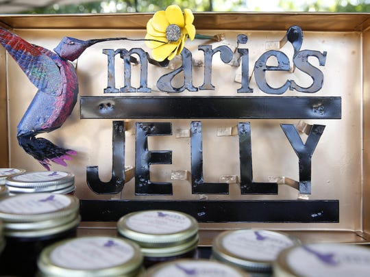 A handcrafted tin sign bring customers in to Marie Garrison's Frenchtown Heritage Market booth.