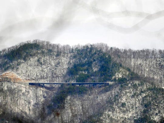 "In this Feb. 10, 2016 photo, a newly constructed bridge is pictured on the Foothills Parkway, near Townsend, Tenn. The bridge is one of nine that eventually will span the rugged 1.6-mile section of the Foothills Parkway, known as the ""Missing Link"". Work is underway to complete the extension of scenic route running near the northern boundary of the Great Smoky Mountains National Park. (Caitie McMekin/Knoxville News Sentinel, via AP)"