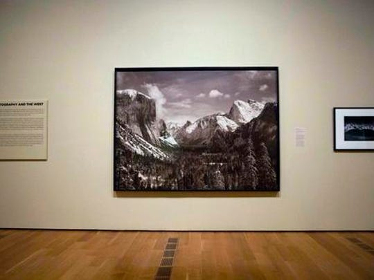 """In this Monday, Feb. 6, 2017 photo, Ansel Adams' 1940 photograph """"Yosemite Valley from Inspiration Point, Winter, Yosemite National Park,"""" is displayed in the exhibit """"Cross Country: The Power of Place in American Art, 1915-1950,"""" at the High Museum of Art in Atlanta. The new exhibition at takes a look at how American artists during the modernist period traveled outside cities to find inspiration in the rural landscape."""