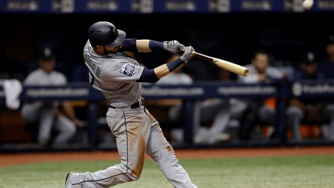 Seattle Mariners' Mitch Haniger connects for a grand slam off Tampa Bay Rays starting pitcher Jake Odorizzi during the third inning of Saturday's game.
