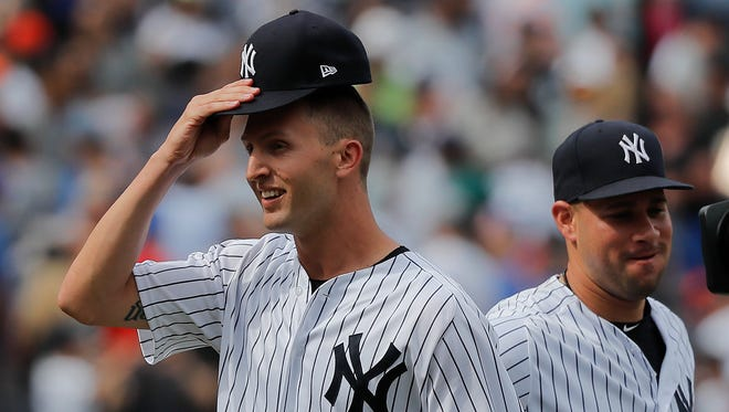 New York Yankees relief pitcher Chasen Shreve, left, tips his cap as he walks off the field at the end of a baseball game against the New York Mets, Saturday, July 21, 2018, in New York.