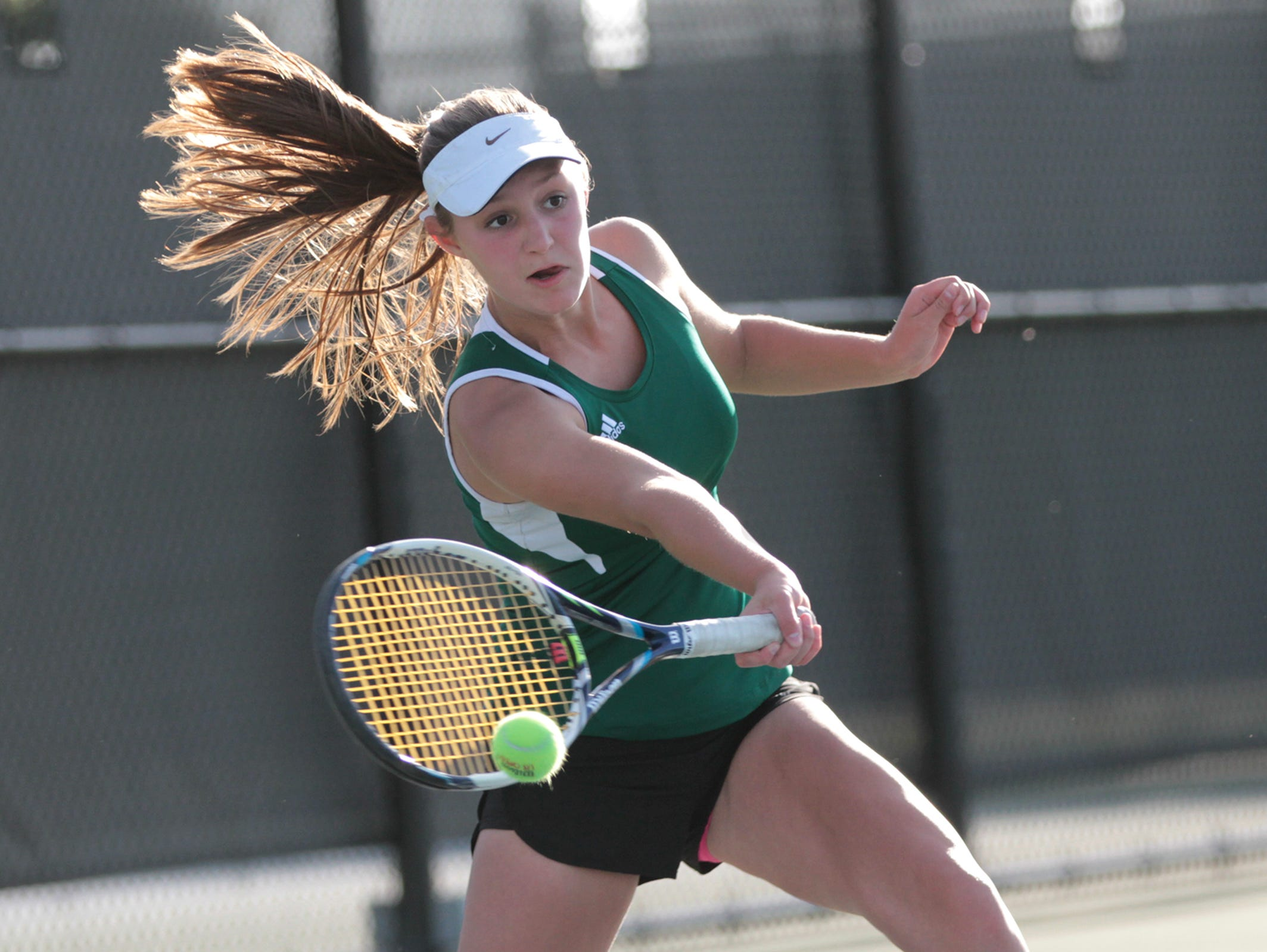 West High's Abby Jans returns her shot during her doubles match with Megan Jans against City High's Innes Hicsasmaz and Eve Small at the Hawkeye Tennis and Recreation Complex on Tuesday.