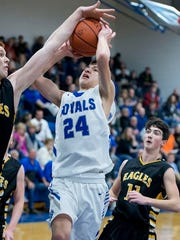 Wynford freshman Josh Crall's shot is shut down by