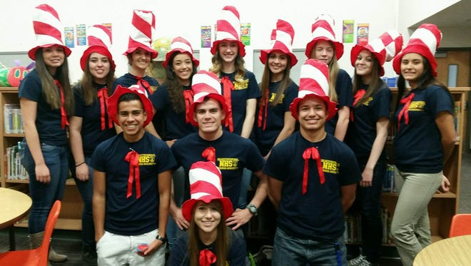 The Cobre High School Chapter of the National Honor Society spent time with Bayard Elementary students today reading and doing activities in honor of Dr. Seuss' birthday. Students included Alexis Madrid, front; Isaiah Soliz, middle row, from left, Dylan Rottman, Corey Roberson; and Estrella Gonzales, back row from left, Cheyenne Cano, Aimee Ryan, Brandy Hernandez, Hannah Burnette, Allison Sedillos, Brooke Elliott, Raquel Parga and Christyn Ortiz.