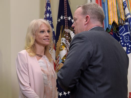 Conway talks with press secretary Sean Spicer in the