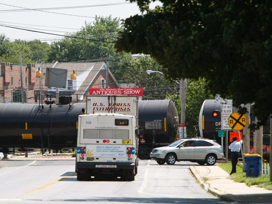 A rail train with mechanical issues stalled traffic along Route 273 near Old New Castle in August 2014. DelDOT plans to rebuild the Route 273 crossing beginning in 2016.