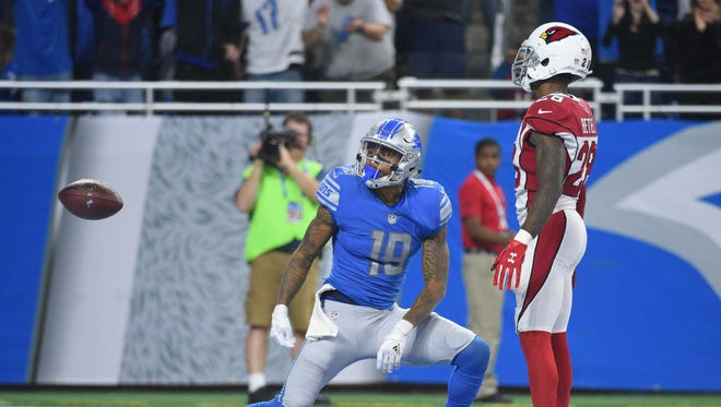 Detroit Lions wide receiver Kenny Golladay (19) celebrates his touchdown during the fourth quarter as Arizona Cardinals cornerback Justin Bethel (28) watches at Ford Field.