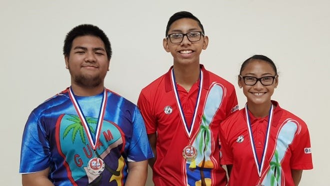 Noah Taimanglo won the February 2018 Triple J Guam Youth Bowler of the month title. From left: Jared Petrus, second place, Noah Taimanglo; and Naiyah Taimanglo, third place.