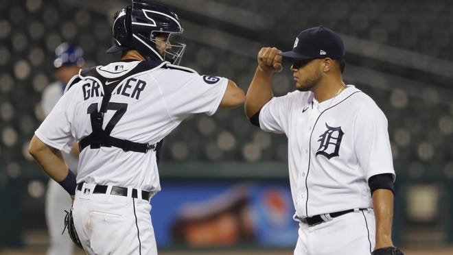 Detroit Tigers relief pitcher Joe Jimenez and catcher Grayson Greiner celebrate after closing the door of a 5-4 win over the Kansas City Royals on Wednesday.