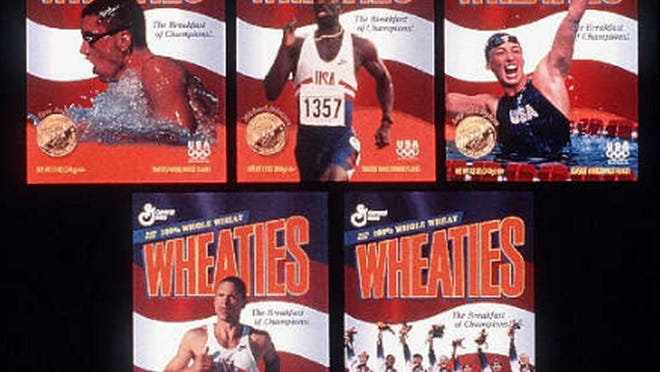 The 1996 Olympic Wheaties boxe, featured gold medalists from the United States Olympic team, incluing, from top left, swimmer Tom Dolan, runner Michael Johnson, and swimmer Amy Van Dyken, and bottom row; decathlete Dan O'Brien and the women's gymnastic team.