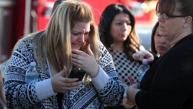 A woman cries at the scene of an active shooter in San Bernardino, Calif., Dec. 2, 2015.