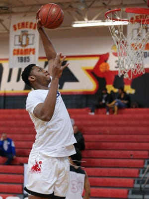 Aspire Academy's Charles Bassey (23) dunked during warmups before their game against Orangeville Prep at Seneca High School.  Feb. 9, 2018