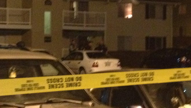 Police remain on the scene of a shooting at Bradford Woods Apartments on Edmondson Pike on Friday night.