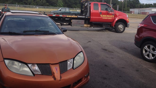 Two men ran from this Pontiac Sunfire as police gave chase.