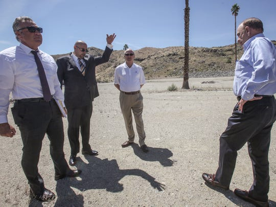 (From the left) Andy Jessup Jr., president of Jessup Auto Plaza which includes Chevy, Buick, GMC and Cadillac, Majed Mansour, general manger of Palm Springs Nissan, Allen Holzhauer, owner of Volkswagen Palm Springs and Wes Hinkle, president of Palm Springs Volvo, on the proposed site of marijuana cultivation facility located behind their auto dealerships. Cathedral City car dealers were banding together to oppose the facilities saying that pot businesses could bring crime and pot odors could drive away business. Photo taken on Wednesday, April 5, 2017 in Cathedral City.