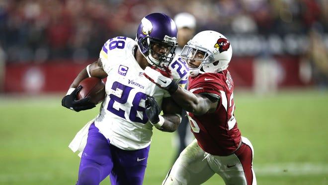 Arizona Cardinals cornerback Justin Bethel tackles running back Adrian Peterson during a NFL game on December 10, 2015 in Glendale.