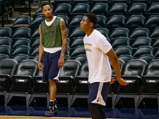 Purdue's Vince Edwards watches as UCLA's Ike Anigbogu