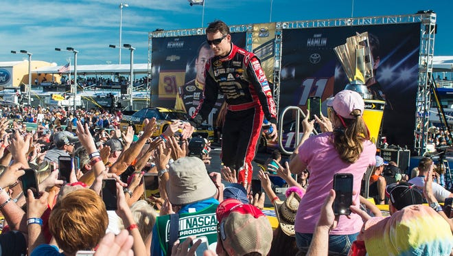 Jeff Gordon is swarmed by fans before the 2014 Sprint Cup season finale at Homestead-Miami Speedway.