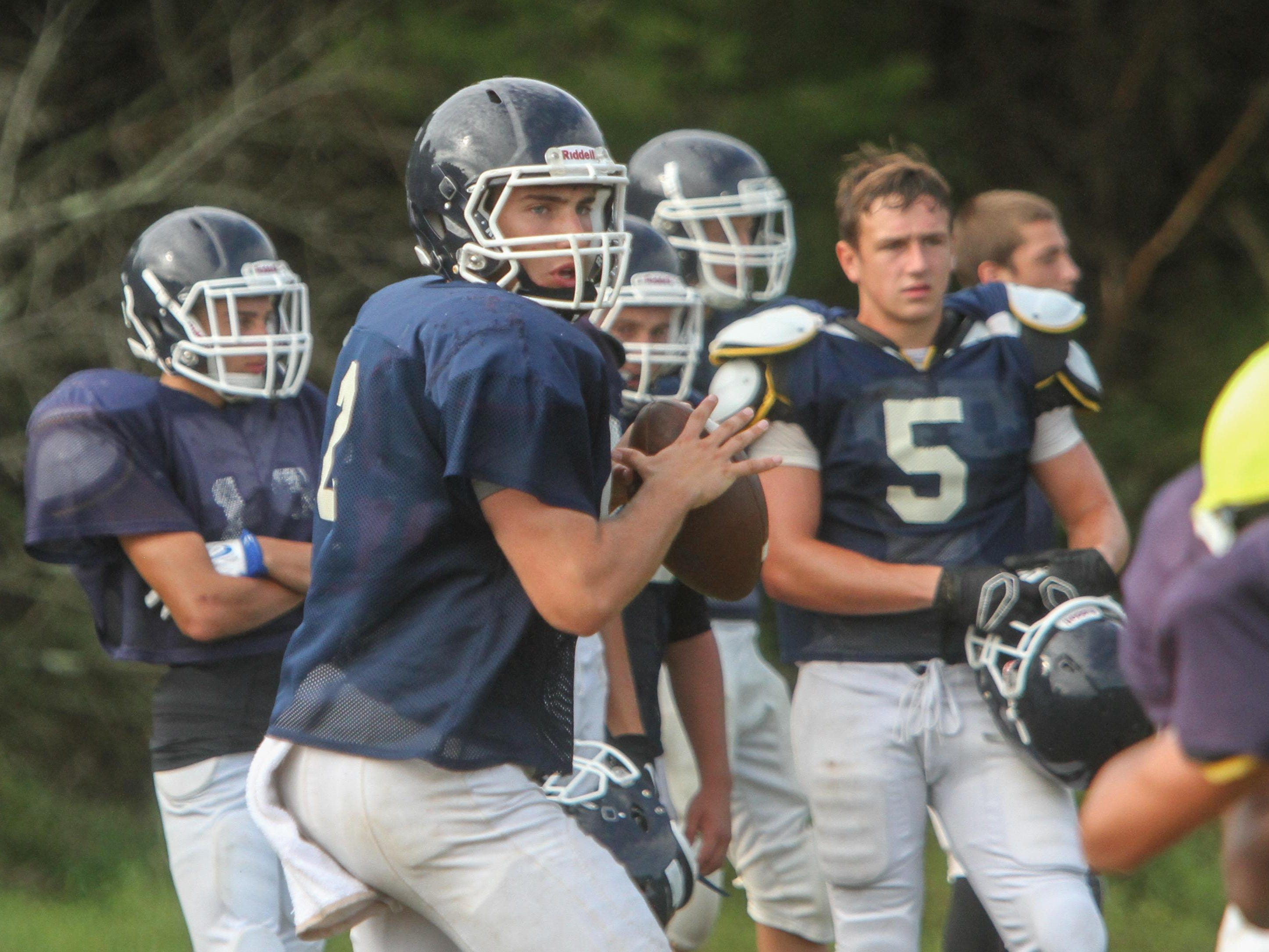 Freehold Township quarterback Jack O'Brien throws during practice.