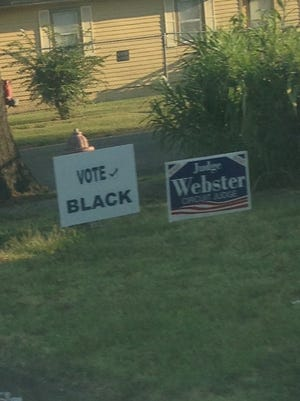 """A """"Vote Black"""" campaign sign appeared next to one for circuit judge Charles Webster, who is white."""