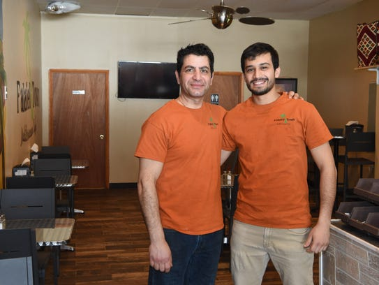 Danny Khalil, left, and Sam Zughayer, right, co-owners