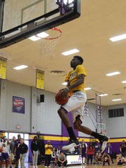 LSUA senior Brandon Moss tries to dunk during the school's