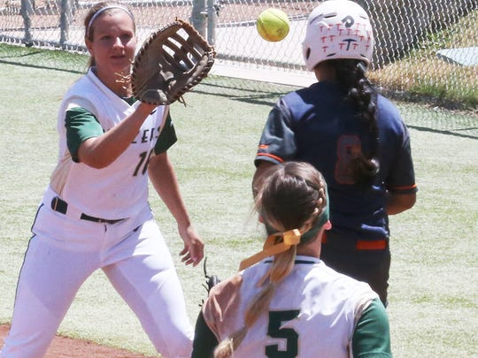 UAB first baseman Sara Bet Williamson, left, gets the throw from third baseman Danii Fernandez, 5, but not before UTEP's Linda Garcia touched the base Sunday at Helen of Troy Field.