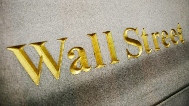 This Oct. 8. 2014, file photo, shows a Wall Street address carved into the side of a building in New York. Global stocks rose Friday, Feb. 13, 2015, after Greece and its European creditors said they were willing to compromise to help Athens with its debts, while fresh data showed improvement in the eurozone's economy. (AP Photo/Mark Lennihan, File)