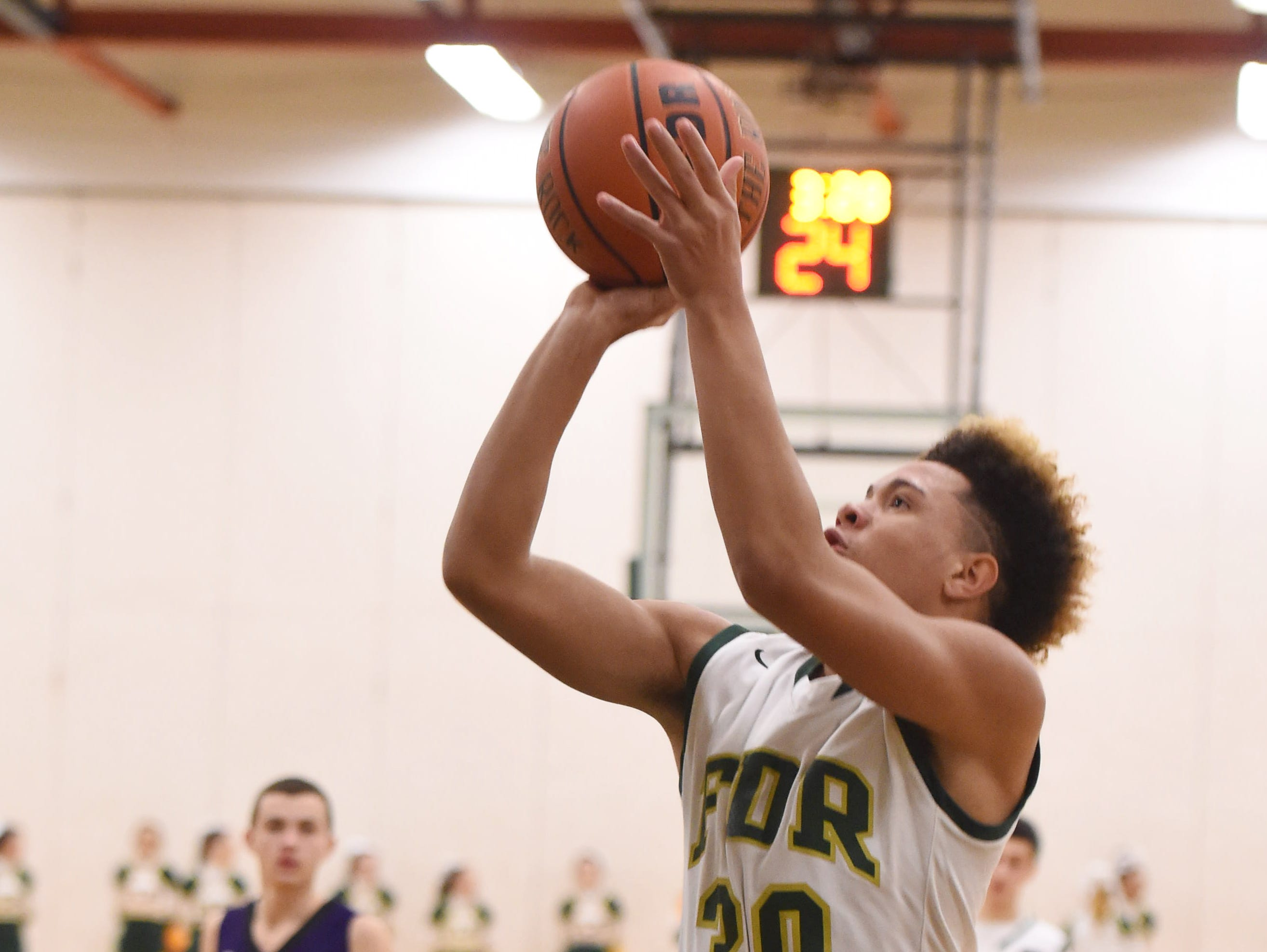 FDR's D'Andre Orr takes a shot over Monroe Woodbury's Mike Mullahy during Monday's game in Hyde Park.