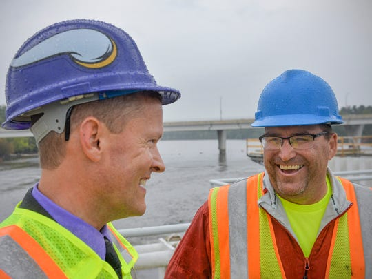 St. Cloud Public Services Director Pat Shea, left, laughs with Daryl Stang, who operates the St. Cloud Hydroelectric Generation Facility, as the two inspect progress Thursday, Sept. 15, 2016, on the installation of new gates.
