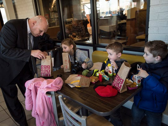 Keewahdin Elementary principal Charles Lesser, left, serves students lunch at McDonald's in Fort Gratiot Township on Wednesday. Students who raised $150 or more as part of the school's Husky Hustle fundraiser were given a ride in a limo to McDonald's and Lakeside Beach.