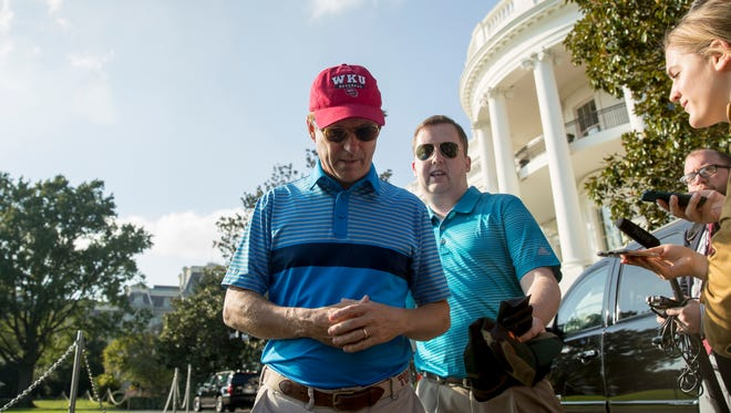 Sen. Rand Paul, R-Ky., accompanied by his communications director Sergio Gor, center right, departs after speaking to reporters on the South Lawn of the White House in Washington, Sunday, Oct. 15, 2017, after playing golf with President Donald Trump at Trump National Golf Club in Sterling, Va.