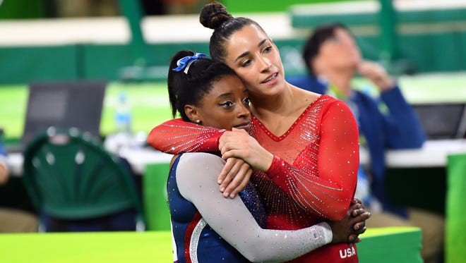 Aly Raisman hugs Simone Biles during the women's individual all-around final in the Rio 2016 Summer Olympic Games at Rio Olympic Arena.
