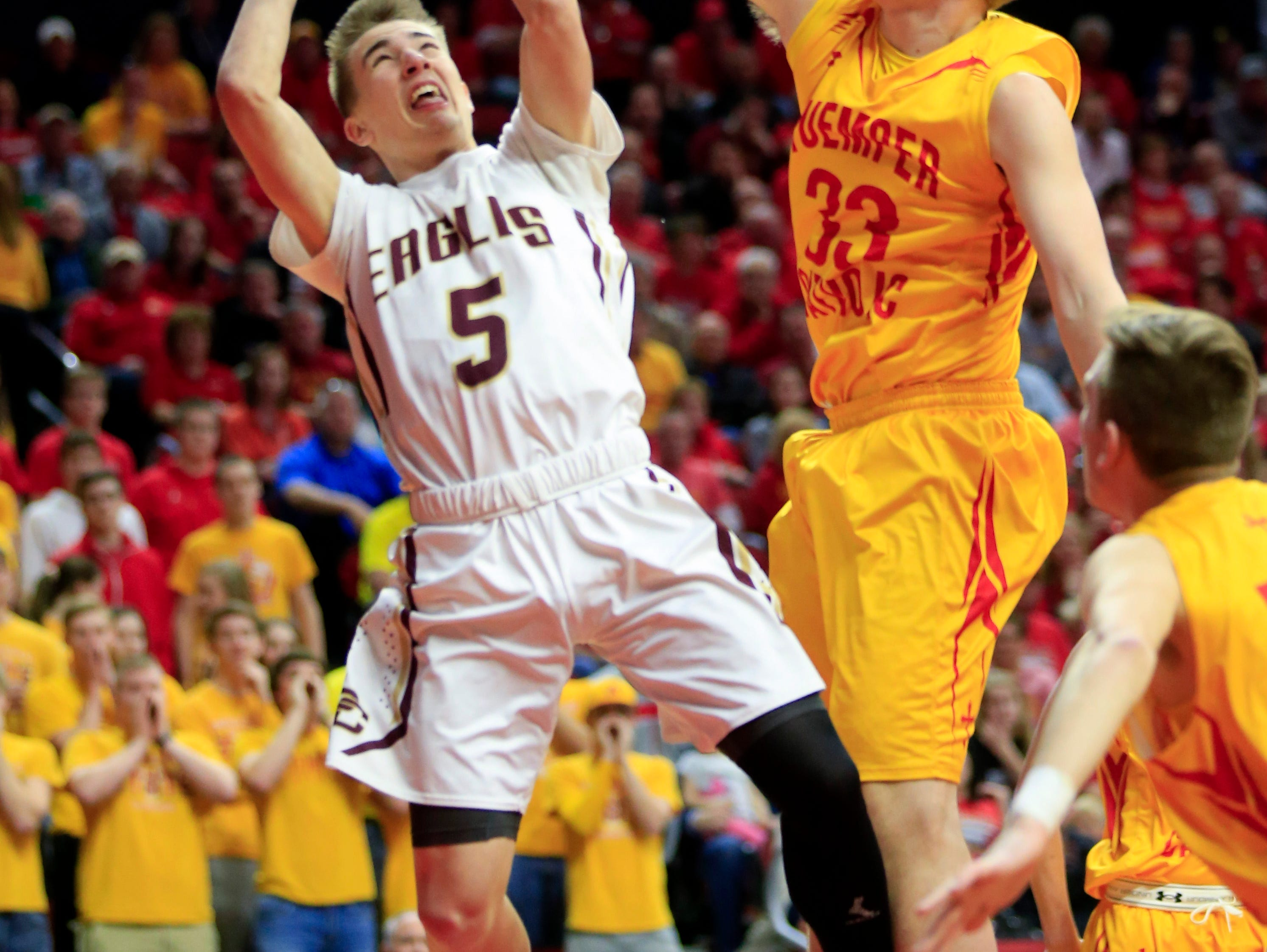 Levi Jungling of Pella Christian has a shot blocked by Matt Dentlinger of Kuemper Catholic in the 2A semifinal game Thursday, March 9, 2017.