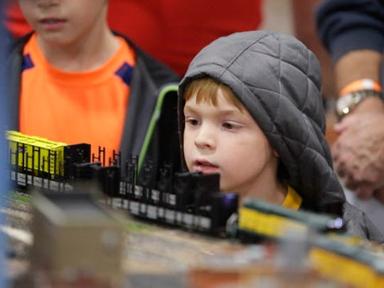 Wade Pheffer, 5 operates a train as part of the Junior Engineer program at  Trainfest, considered America's largest  operating model Operating Railroad show, at  Wisconsin State Fair Park.