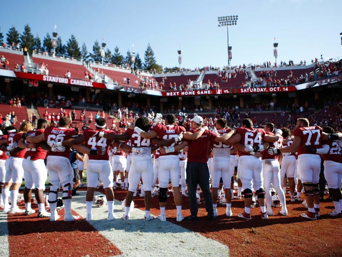 Stanford Cardinal players gather after defeating the