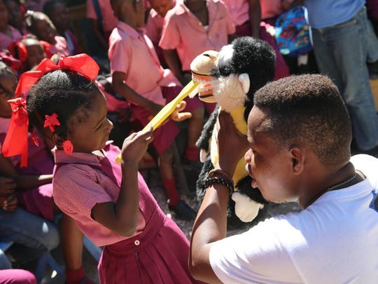 A child learns proper mouth care through the Health for Haiti course at SUNY Broome.