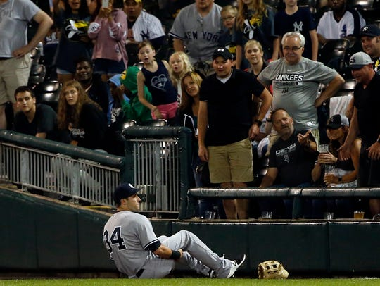 New York Yankees' Dustin Fowler sits on the field after