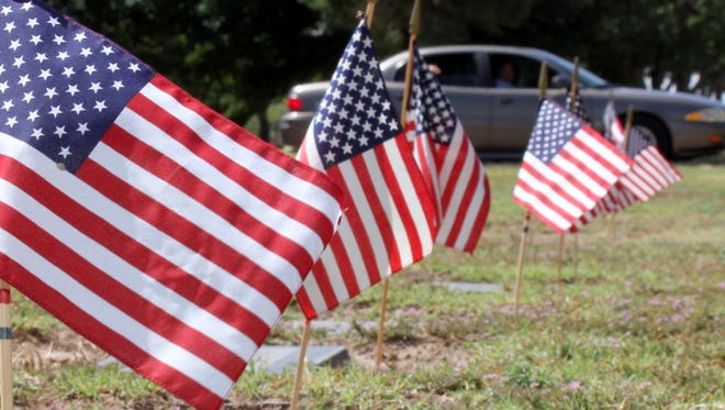 The American Legion Bataan Post 4 members planted 837 flags at the tombstones of veterans at Mountain View Cemetery in honor of Memorial Day.