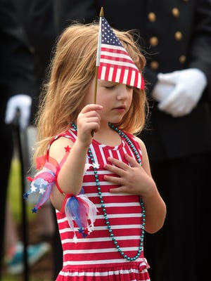Granddaughter of a veteran, 6-year-old Olivia Costa of Whippany, covers her heart during the memorial service before the 2014 Morris Plains parade. This year's 29th annual Memorial Day parade is set for Saturday -- May 23 -- at 9:30 a.m. (Bob Karp/staff photographer)