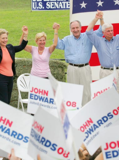 From left: Barack Obama, Bill Richardson, Hillary Clinton, Ruth Harkin, Tom Harkin, Chris Dodd, John Edwards and Joe Biden hold hands at the end of Harkin's steak fry in Indianola on Sept. 16, 2007.