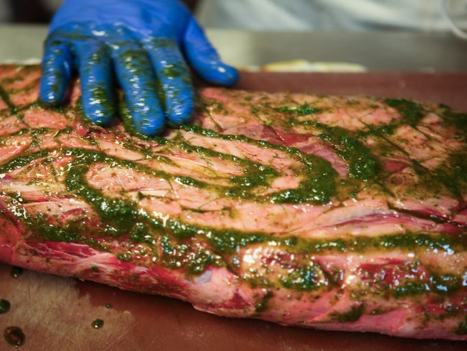 """Jeffersonville Bristol Bar & Grill Chef Richard Doering prepares a prime rib Friday. The restaurant will be serving prime rib during Thunder. """"Every year I try to do something a little different, something that customers may not normally get here,"""" Doering said. March 28, 2014"""