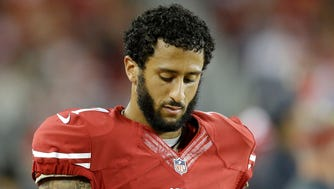 San Francisco 49ers quarterback Colin Kaepernick (7) stands on the sideline during the second half of an NFL football game against the Seattle Seahawks in Santa Clara, Calif., Thursday, Oct. 22, 2015.