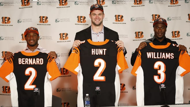 Bengals second-round draft picks Giovani Bernard (left) and Margus Hunt joined third-round pick Shawn Williams in holding up their draft jerseys during an introductory press conference at Paul Brown Stadium.