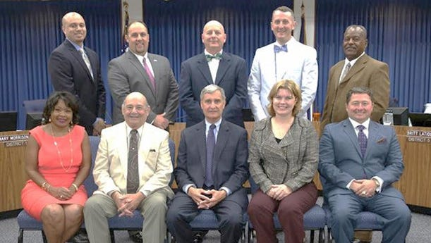 The Lafayette Parish School Board is pictured with Superintendent Donald Aguillard.